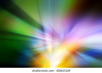 Abstract background representing speed, motion and burst of colors and light in blue, purple, yellow, orange and green colors.