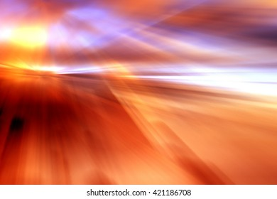 Abstract background representing speed, motion and burst of colors in purple, pink, orange and red colors.