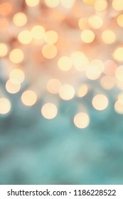 Abstract background of retro tinted holiday bokeh lights with free space for text.