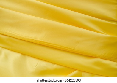 Abstract background of ribbon wave elegant bright yellow textile