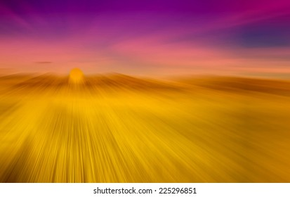 abstract background of rice field and blue sky with radial blur