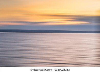 abstract background at the sea at sunset (motion blur)