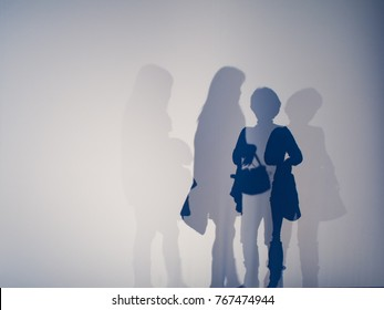 abstract background of shadows people on a white wall.