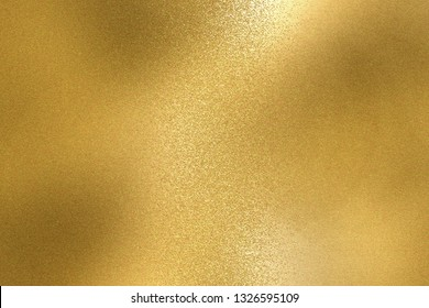 Abstract background, shiny yellow metal foil texture
