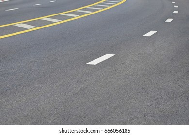 Abstract background with space for text of new beautiful rough asphalt road with a white line.