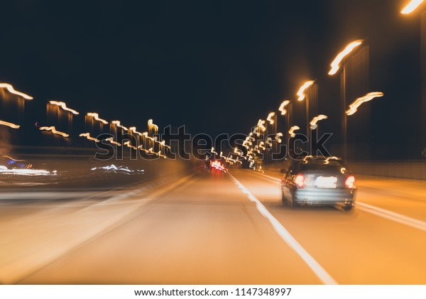 Abstract background - speed and lights, cars on the night road, matte toning effect