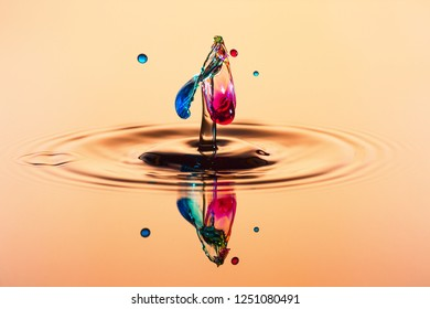 abstract background of splash of color water, collision of orange colored drops, the concept art