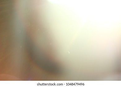 Abstract background. Sun rays with bokeh and lens flare.