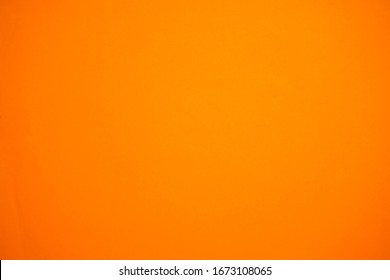 abstract background with surface of orange paper for background ,vintage style.