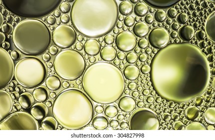 Abstract background and texture of blue bubbles with light illumination. The art of water surface for your products display and artwork design with copy space. Watery glare like jewelry so beautiful.