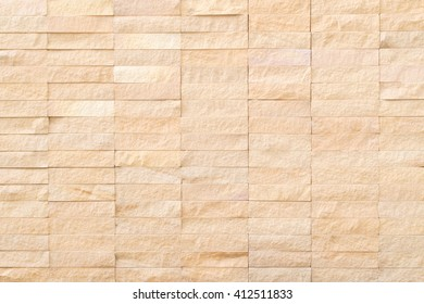 Abstract background of  texture brick light brown yellow in  urban room, grungy blocks of stonework technology color horizontal architecture wallpaper