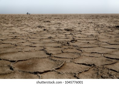 abstract background texture of the desert of salt in africa ethiopia danakil region of afar concept of wilderness and danger place with car