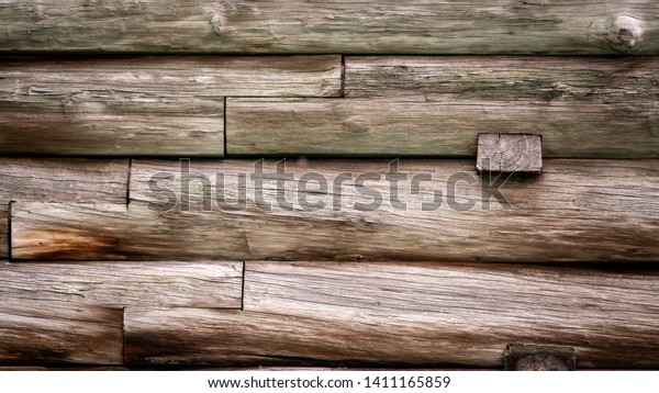 Abstract Background Texture Detail of a Wooden Wall with cracks and grunge.