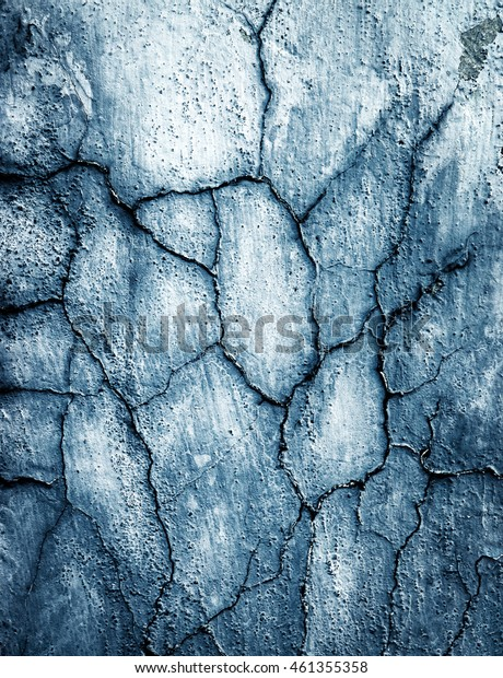 abstract background or texture old blue-gray plaster with cracks