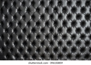 Abstract background texture of an old natural luxury, modern style leather with rhombs. Classic black grungy skin of retro wall, door, sofa or studio interior.