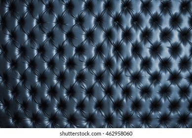 Abstract background texture of an old natural luxury, modern style leather with rhombs. Classic blue grungy skin of retro wall, door, sofa or studio interior.