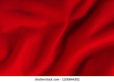 abstract background from the texture of red cashmere cloth