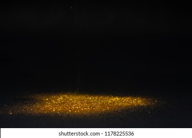 Abstract background texture Sprinkle gold dust in the dark with copy space.