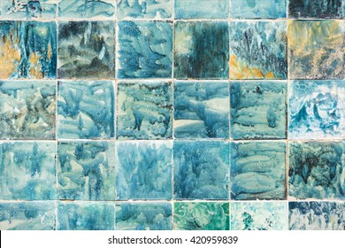 abstract background of tiles hand painted in blue and green colors