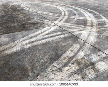 Abstract background tire tracks on cement floor, Tire trace on the ground, tire marks on cement floor.