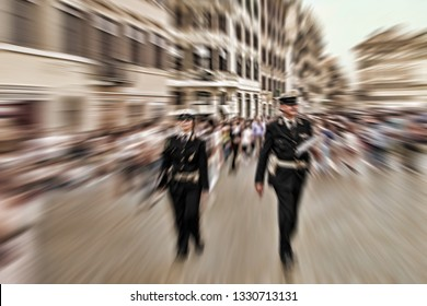 Abstract background. Two  police officers walking along the streets of Rome, Italy. Radial zoom blur effect defocusing filter applied, with vintage instagram look.