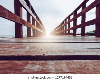 Abstract background walkway on wooden bridge with light at the end represent gateway of new happy life ending exit darkness entrance to freedom new journey of shine with success vision and wisdom