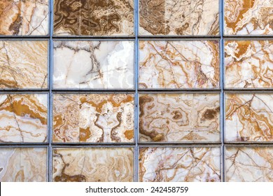 Abstract background wall with brown and ocher lines and curves.