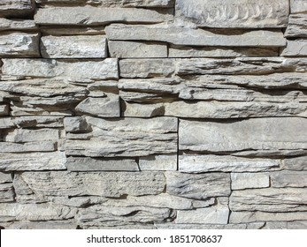 Abstract background wall covered with stone. Stone wall background brown. Decorative stone on the wall. Selective focus