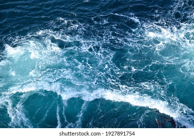 Abstract background. The waves of the sea water meet with underwater pointed rocks, forming whirlpools. Whirlpools in the area of the Norwegian city of Bod?. Norway