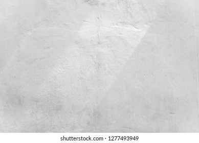 Abstract background from white concrete wall with sunlight, light and shadow.