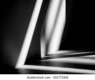 Abstract background of a white wall with shadows from the window. - monochrome