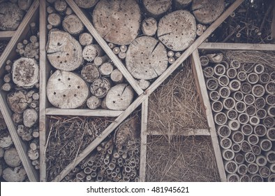 Abstract background with wood logs on a shelf with hay