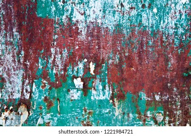 Abstract background of wornout corroded texture in red and green paint color.