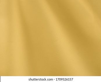 Abstract background, yellow elegant fabric or liquid waves or jagged edges. Seamless pattern of satin cotton.