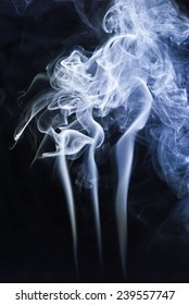 abstract background,blue smoke on a dark