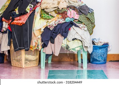 abstract The basket with not folded clothes, clothes are not wash
