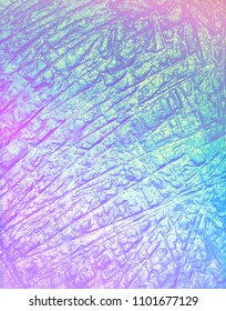 Abstract beautiful holographic wrinkled foil texture with vibrant colors. Trendy background