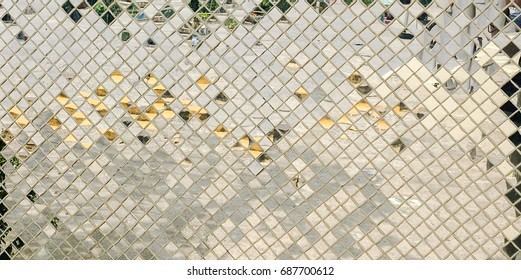 Abstract beautiful of Reflective Mosaic Silver tiles wall texture, Silver glitter wall , Silver glitter mirror on decorative wall. Selected focus.