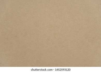 Abstract beige recycled paper texture background or backdrop. Empty old cardboard or recycling paperboard for design element. Simple light brown grainy surface for journal template presentation.