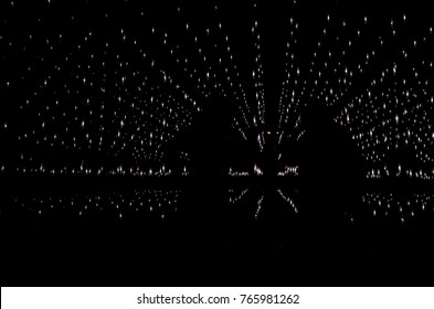 Abstract black background with lights and people silhouette