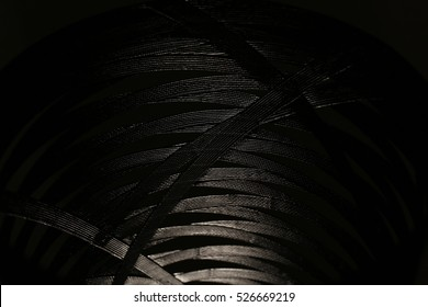Abstract black background, pattern of black plastic strap for background.