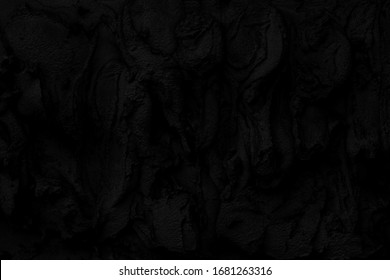 Abstract black background. Black stucco texture. Dark rough surface. Architectural stucco molding made of cement.