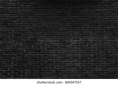 abstract black brick wall pattern background, rough solid texture and grunge surface backdrop for architecture material decoration or retro interior room concepts