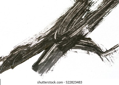 abstract black brush strokes on white paper