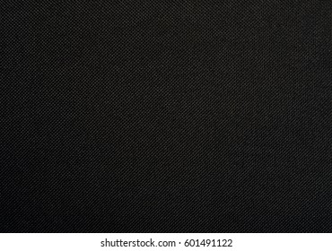 Abstract black fabric texture background or dark grey cloth texture seamless background
