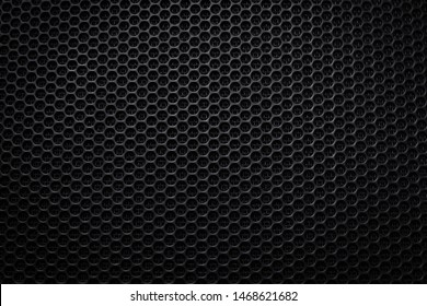 Abstract black metallic mesh texture pattern for background. Industrial backdrop. The speaker of a musical column. Copy space.