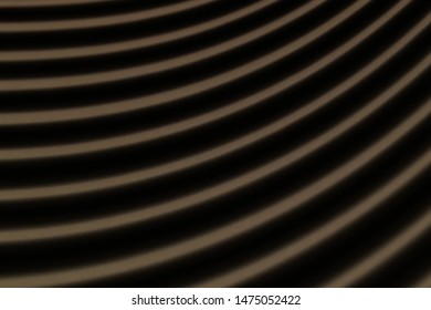 abstract black paper background with Golden stripes. the paper is illuminated through the half-open blinds. shallow depth of field.
