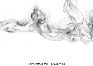 Abstract black smoke texture movement on white background, Black toxin smoking from cigarettes or bad engine and pollution industry concept. art smoke for using negative positive idea to advisement.