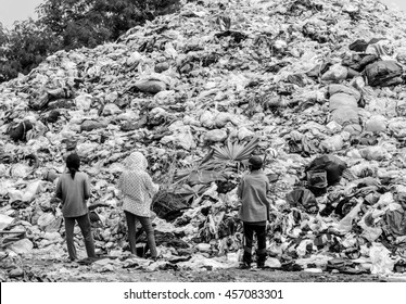 Abstract black and white blur picture of people in landfill of Thailand, Picture for background