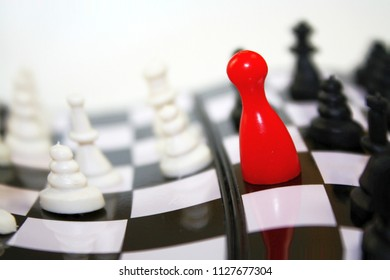 Abstract black white red photo of curvy chessboard with chess pieces and bright red lugo figure